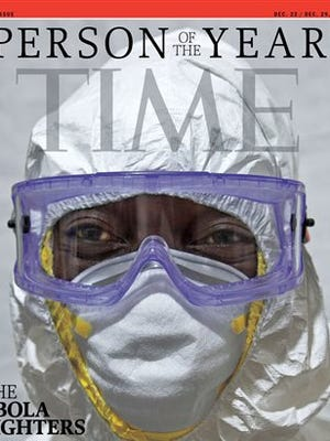 This image provided by Time Magazine today  announces the Ebola fighters as its Person of The Year for 2014. The title, according to the magazine, goes to an individual or group who has had the biggest impact on the news over the course of the previous year. The issue carries five covers, and here, shows Dr. Jerry Brown, the Liberian surgeon who turned his hospital's chapel into the country's first Ebola treatment center.