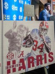 Alabama running back Damien Harris talks to the press