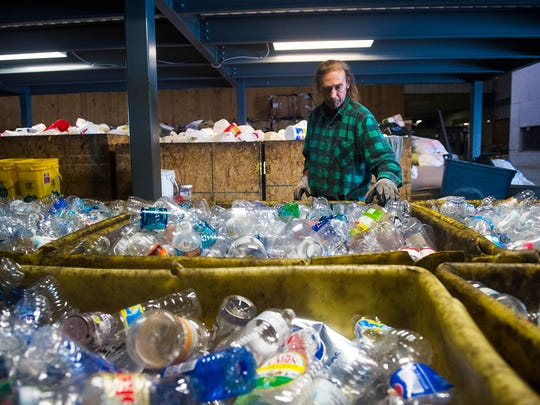 William Kern sorts through plastic bottles in the recycling area close to where the e-cycling materials used to be stored at the Adams Rescue Mission on May 2. The Rescue Mission, which served as a hub for Adams County residents' recycled electronics, stopped its e-cycling program because, officials say, the mission could no longer afford the costs.