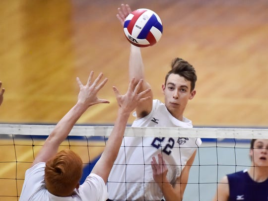 Chambersburg's Landon Miller spikes the ball during a boys volleyball game on Wednesday, May 11, 2016 in Chambersburg, Pa.