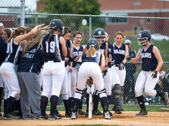 Chambersburg's softball team celebrates with Tara Harmon after her 100th hit during the Mid Penn semi finals on Tuesday, May 17, 2016 in Newville, Pa. Chambersburg defeated West Perry 9-3.