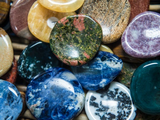 Worry stones to ease stress are displayed at Gettysburg metaphysical store, Zen & Now, on May 18, 2016.