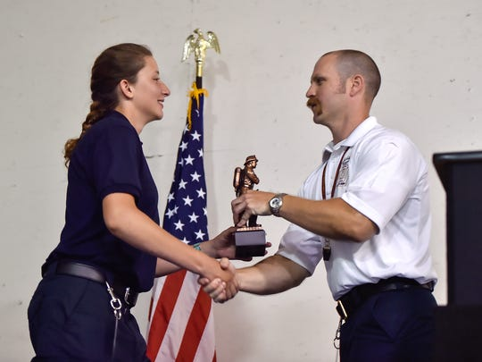 Kara Wright recieves two awards during the Franklin County Junior Firefighter Academy graduation on Saturday, July 23, 2016 in Chambersburg, Pa.