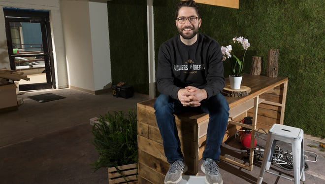 Flowers for Dreams co-founder and CEO Steven Dyme sits in the company's soon-to-open location at 134 W. Pittsburgh Ave.