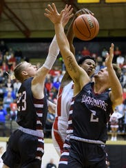 Danville's Dillon Ware (23) attempts to stop Bosse's