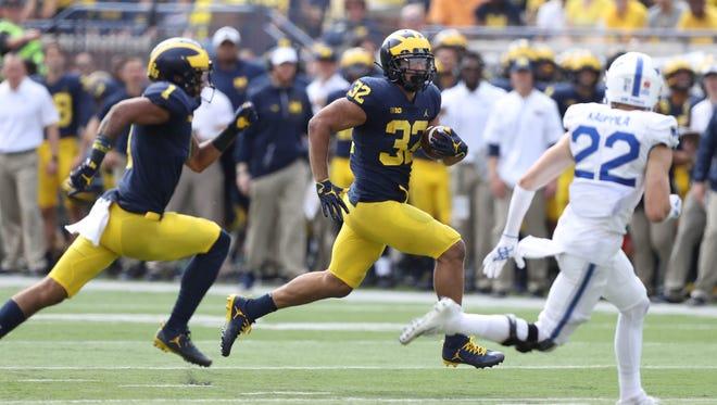 Michigan's Ty Isaac runs the ball against Air Force during the third quarter Saturday, Sept. 16, 2017 at Michigan Stadium.