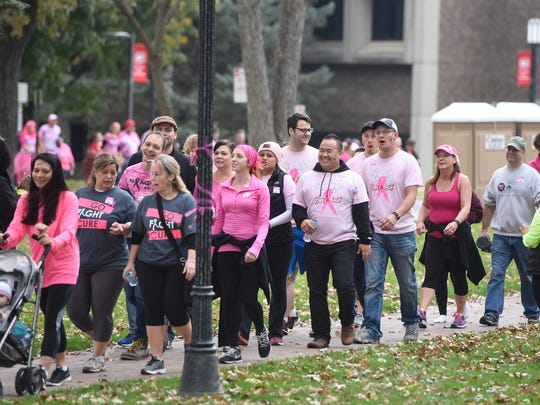 People follow the route through Barden Park during the Making Strides of Central Minnesota breast cancer walk at St. Cloud State University.