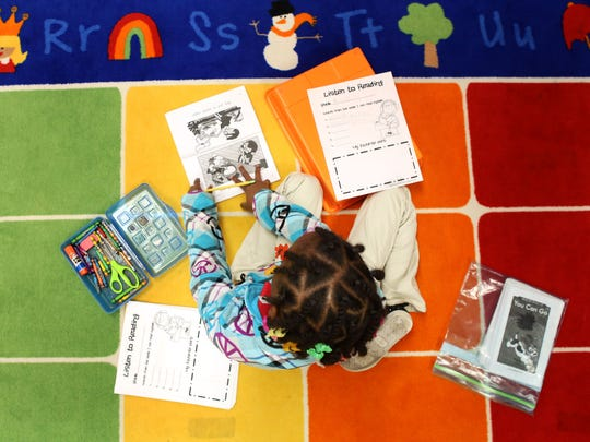 Bre'Aja Wilson-Green works on her reading skills, during an independent study period at George and Veronica Phalen Leadership Academy in Indianapolis Thursday, May 13, 2015.