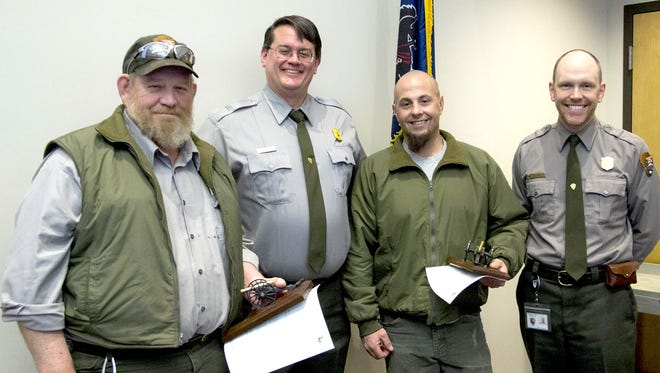 """Pictured, from left, are: Walter """"Buzzy"""" Baker, award winner; Superintendent Ed Clark; Joshua Francisco, award winner; and Greg Goodell, incentive awards committee chair."""