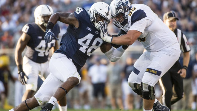 Defensive end Shareef Miller (48) turned in an overpowering debut in Saturday's opening victory over Kent State.  His performance gave hope that Penn State's rebuilt defensive line can succeed with numbers.