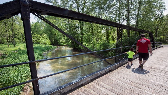 A re-purposed historic bridge that makes access possible from a parking lot to the York County Heritage Rail Trail was moved from Glatfelters Station road after it was obsolete and repurposed by the Kinsley family.