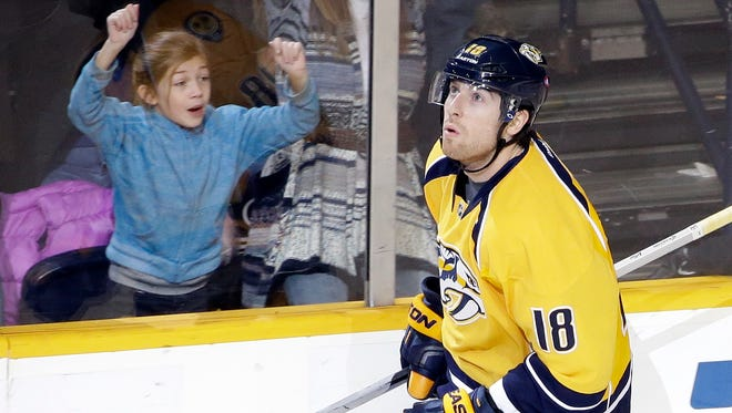Nashville Predators left wing James Neal skates back to the bench after scoring the winning goal during a shootout against the Los Angeles Kings on Tuesday.