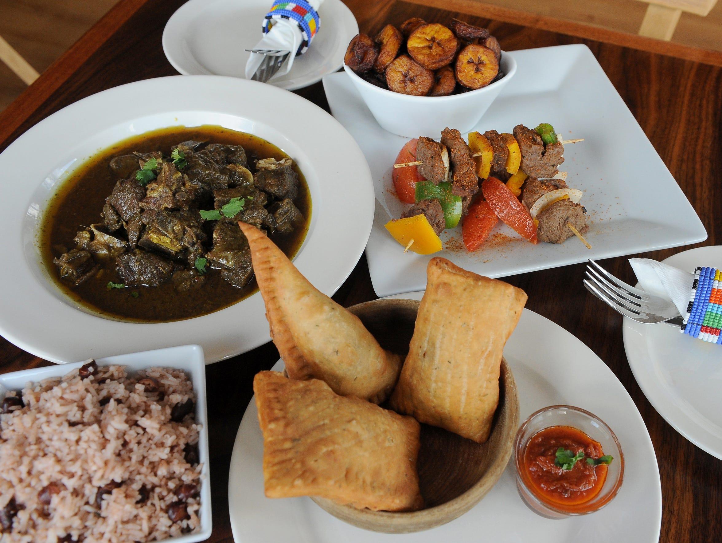Rice and peas, curry goat, sweet plantain, chichinga
