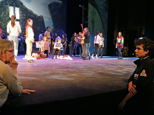 """Choreographers Claire Williamson, left, and Will Scheffler talk during rehearsal for Appleton North High School theater's production of """"The Pirate Queen."""""""