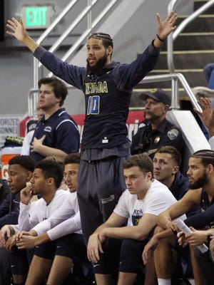 Nevada's Caleb Martin, sidelined with a sprained ligament in his foot, cheers his teammates on from the bench Saturday in a win over San Diego State.