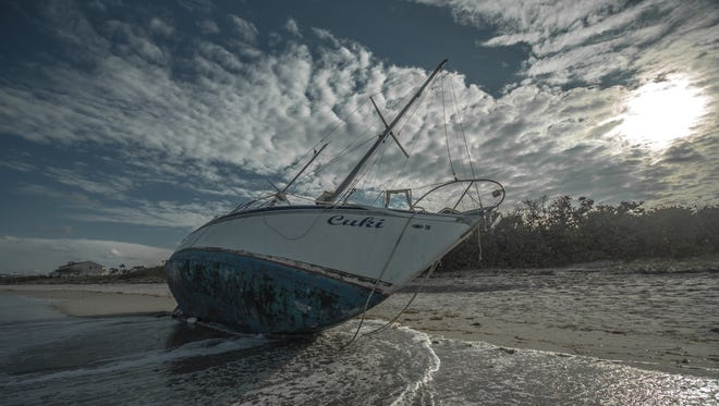 """Vic Pal: """"Just went out by my condo last night and found this sailboat laying on a beach."""" Shown is the Cuki mystery sailboat aka a """"ghost ship"""" that showed up on Melbourne Beach on Sept. 19, 2017."""