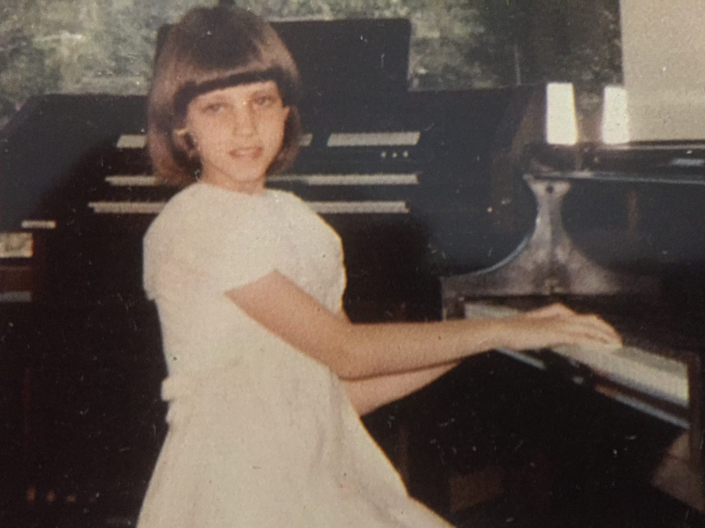 Caroline McGehee Small, taking part in a piano recital as a child.
