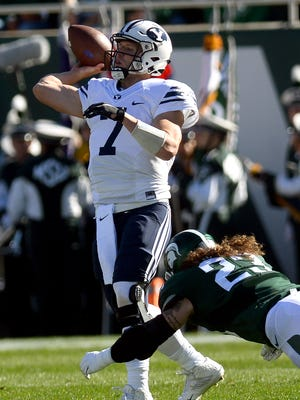 Michigan State University  junior linebacker Chris Frey (23) pressures BYU senior quarterback Taysom Hill (7) as he attempts a pass in the first half of MSU's game against BYU Saturday, October 8, 2016 in East Lansing.