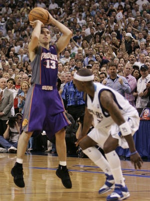 The crowd watches as Phoenix Suns' Steve Nash goes up for a 3-point shot that sent Game 6 of the Western Conference semifinals into overtime, on Friday, May 20, 2005, in Dallas. Phoenix won 130-126 and won the series 4-2. In the foreground is Mavericks' Jason Terry.