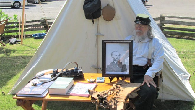 Civil War reenactor Doug Osborn displays a photo of Col. Hiram Berdan, who headed up a special unit known as Berdan's Sharpshooters. This group was the original special forces unit of the U.S. Army.