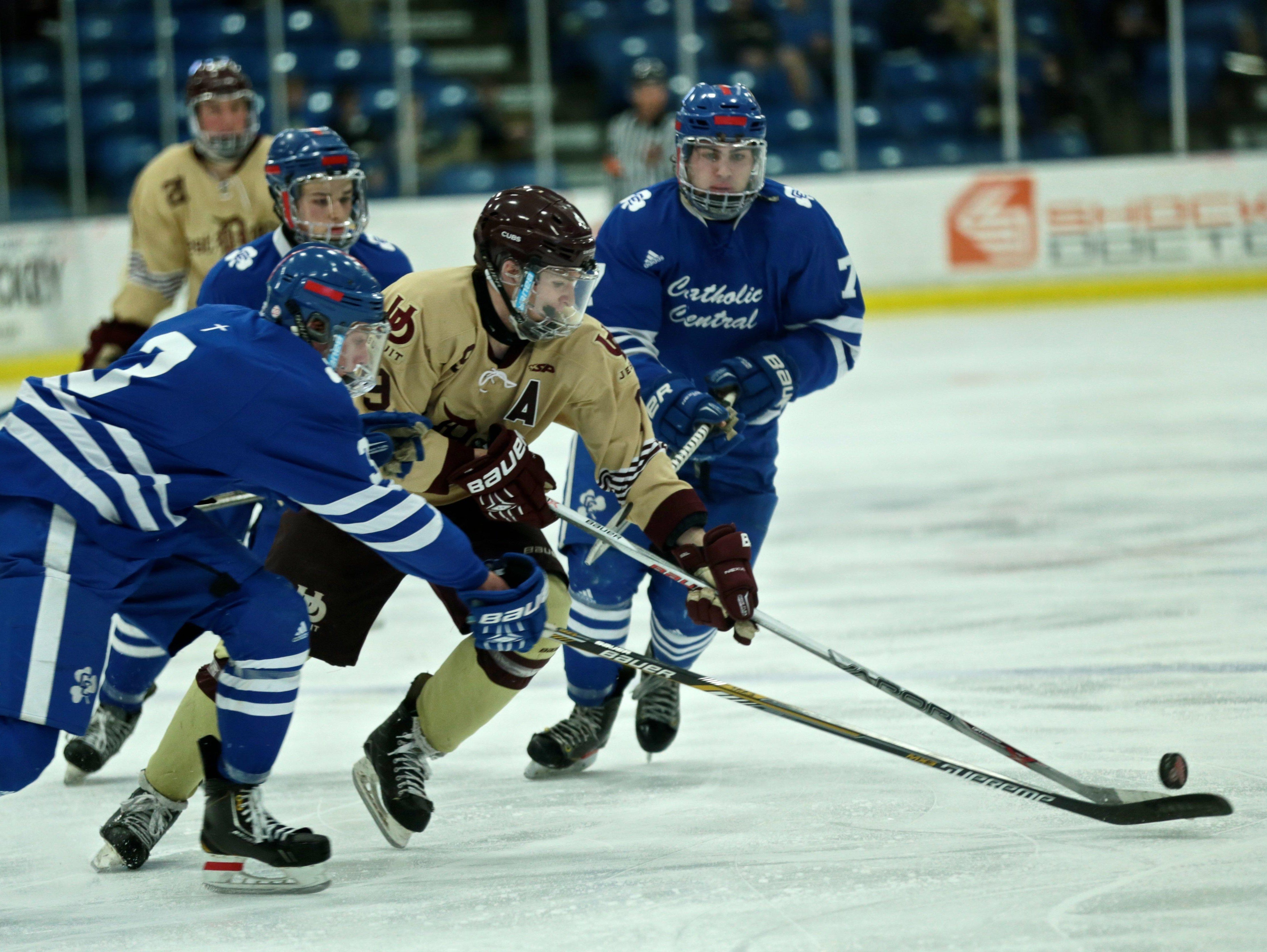 Detroit U-D Jesuit's Tommy Apap (9) skates with the puck during Detroit Catholic Central 4-3 win in the Division 1 state semifinal on Friday, March 11, 2016, at USA Hockey Arena in Plymouth, MI.