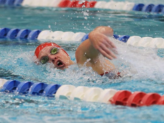 Canton senior Meghan Mans competes during the 500 freestyle