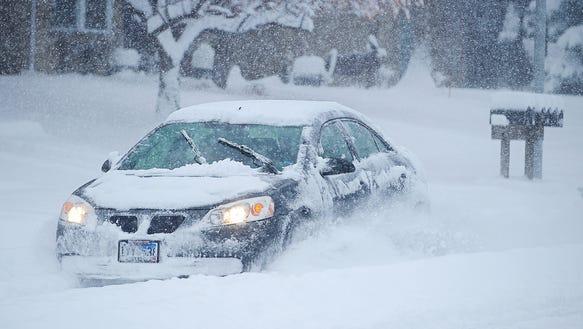 A motorist makes their way through the snow on Kris