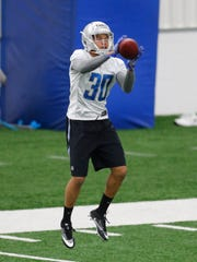 Lions cornerback Teez Tabor catches a ball during the