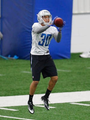 Lions cornerback Teez Tabor catches a ball during the team's rookie minicamp in Allen Park on May 12, 2017.
