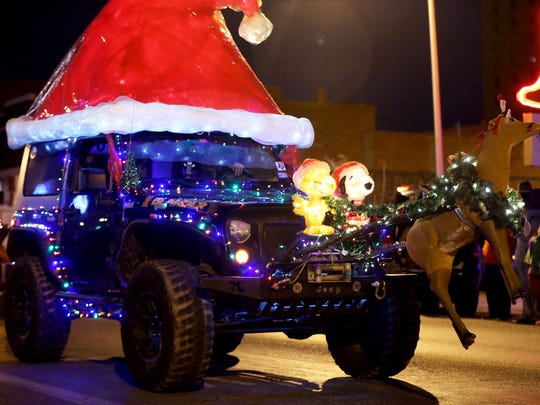 Participants ride in the annual Lights of Christmas
