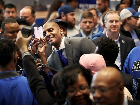 A crowd of fans gathers around Penny Hardaway during a news conference at the the University of Memphis to announce the former Tigers star as its new men's basketball coach at the Laurie-Walton Family Basketball Center.