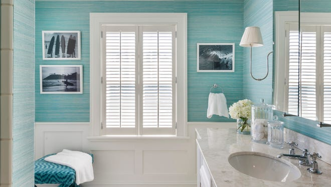 Painted walls would look perfectly fine in this Rhode Island bathroom. But interior designer Jackson choose a rich, textured wall covering in a mix of blue/green shades that brings a huge dose of style to this simple space.