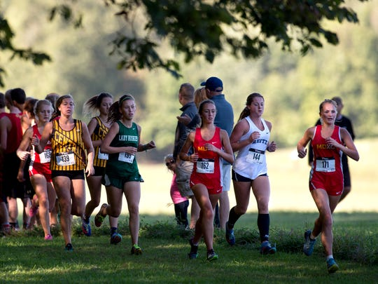 The girls varsity race takes place during the SIAC cross country meet at Angel Mounds in Evansville, Ind., on Saturday, Sept. 30, 2017.