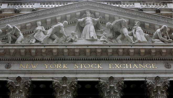 FILE - This Oct. 4, 2014, file photo, shows the facade of the New York Stock Exchange.
