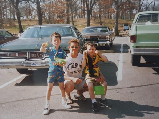 Rusty (left) and Josh Larabell (right) pose with older half-brother Ben Welzbacher in their hometown of St. Louis, Missouri, in this undated photo. Rusty Larabell was a sophomore at Naples High School when he died from a brain aneurysm suffered during a junior varsity football game in October 1998.