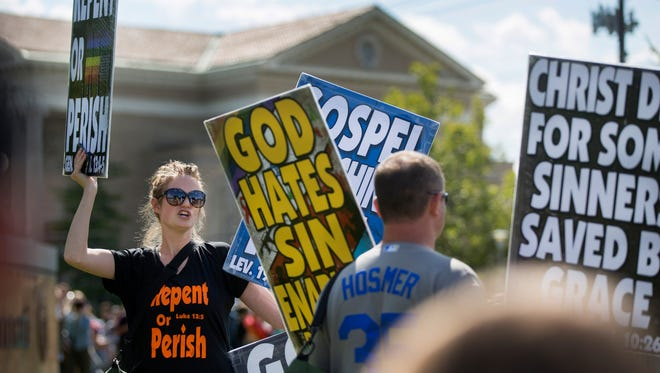 """Five people from the Westboro Baptist Church in Kansas were shouted down by hundreds of counter protestors on the University of Cincinnati's campus. The protest was held at the corner of Clifton and Martin Luther King Jr. Drive in Clifton. The Westboro group were protected by sheriff's deputies and kept separated by temporary fencing. The protest, planned for 30 minutes, lasted less than 15. Counter protestors chanted, """"Love Trumps Hate""""."""