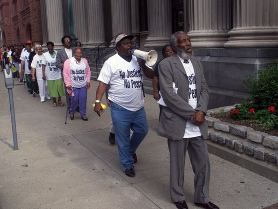Dick Gregory, right, and the Rev. Louis Coleman led