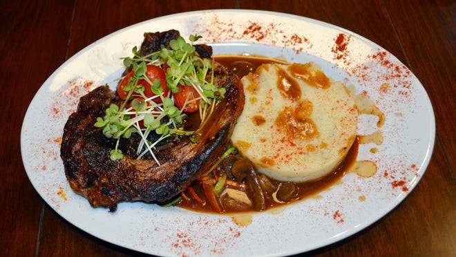 Four Corner's ribeye dinner includes a 12-oz steak, mashed potatoes, mushroom sauce and vegetables, plus salad or soup.