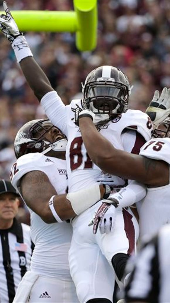 Mississippi State wide receiver De'Runnya Wilson (81) celebrates with teammates after catching a touchdown pass against Texas A&M during the second quarter of an NCAA college football game Saturday, Nov. 9, 2013, in College Station, Texas. (AP Photo/David J. Phillip)