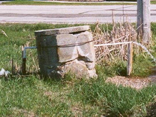 The artesian spring located at Spring Corners provides fresh, clean water to area residents.