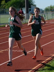 Oak Harbor's Abby Eoff, left, and Paige Priesman compete in the District 1 girls 1,600-meter run Friday.