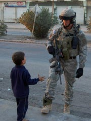 Eric Johnson talks with a child during his deployment