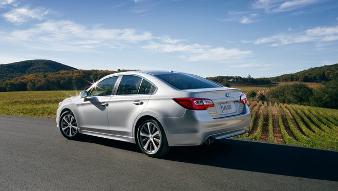 The 2015 Subaru Legacy prowls on 18-inch alloys and breathes through dual exhaust outlets next to wrap-around tail lamps.