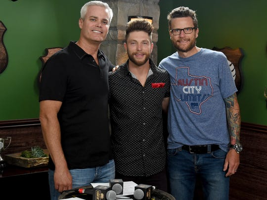 Singer Chris Lane (center) meets radio personalities