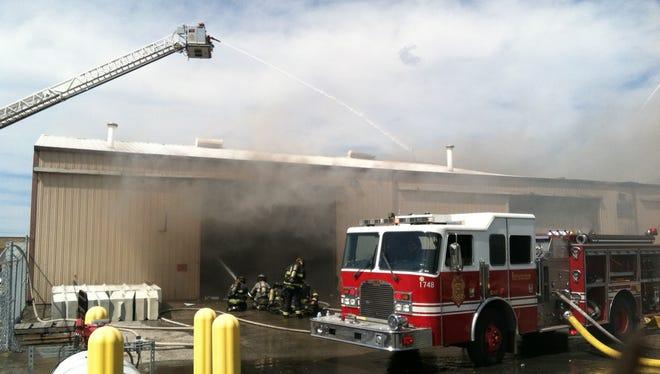 Crews battle a fire at Roche Diagnostics, Aug. 4, 2015.