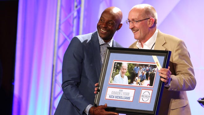 South Salem's Nick McWilliams poses for a picture with Jerry Rice as he accepts the Mid-Valley Coach of the Year award during the Mid-Valley Sports Awards banquet on Tuesday, June 7, 2016, at the Salem Convention Center.
