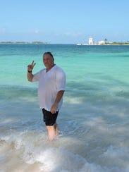 Michael Benanti poses in the Bahamas, where he said
