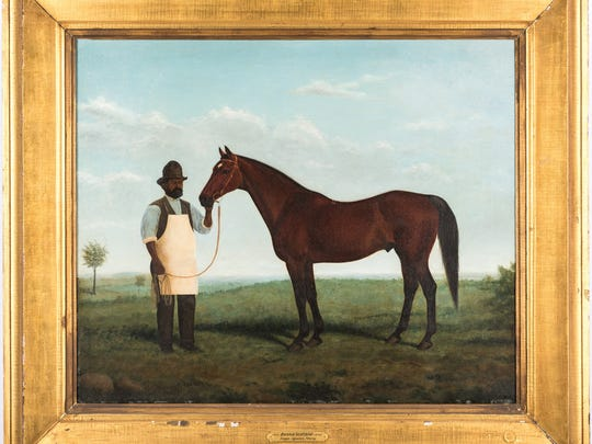 This portrait of thoroughbred Bonnie Scotland and Bob Green, chief groom at Belle Meade horse farm, was painted around 1879. It's up for auction Saturday by Case Antiques and is estimated to bring $36,000 to $40,000. A number of famous horses, including Man O'War, Secretariat and Seabiscuit, trace their blood lines to Bonnie Scotland.