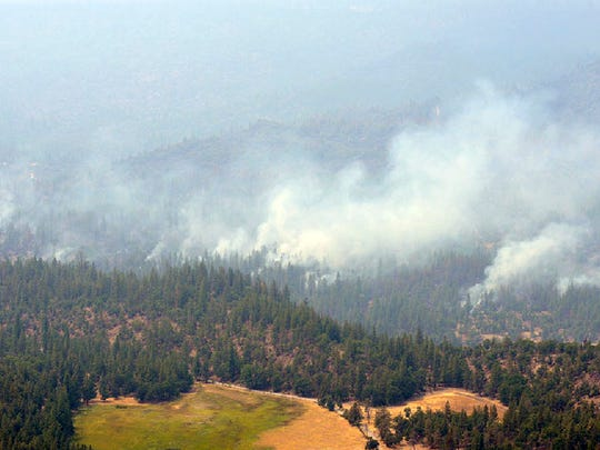 This Aug. 5, 2014 image provided by the Oregon Military Department of Public Affairs shows fires burning near Ashland.