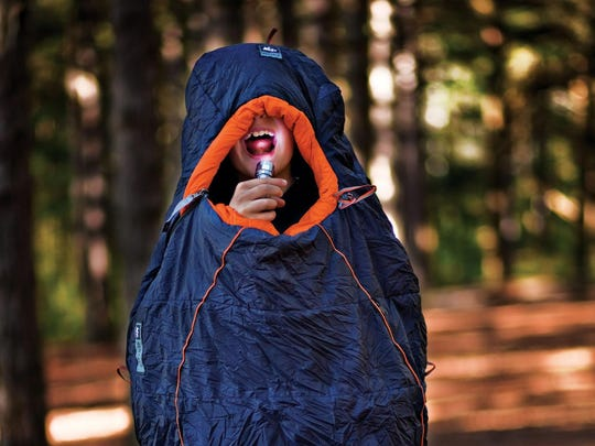 Snuggle into a sleeping bag for a camping adventure at a Wisconsin park this summer.